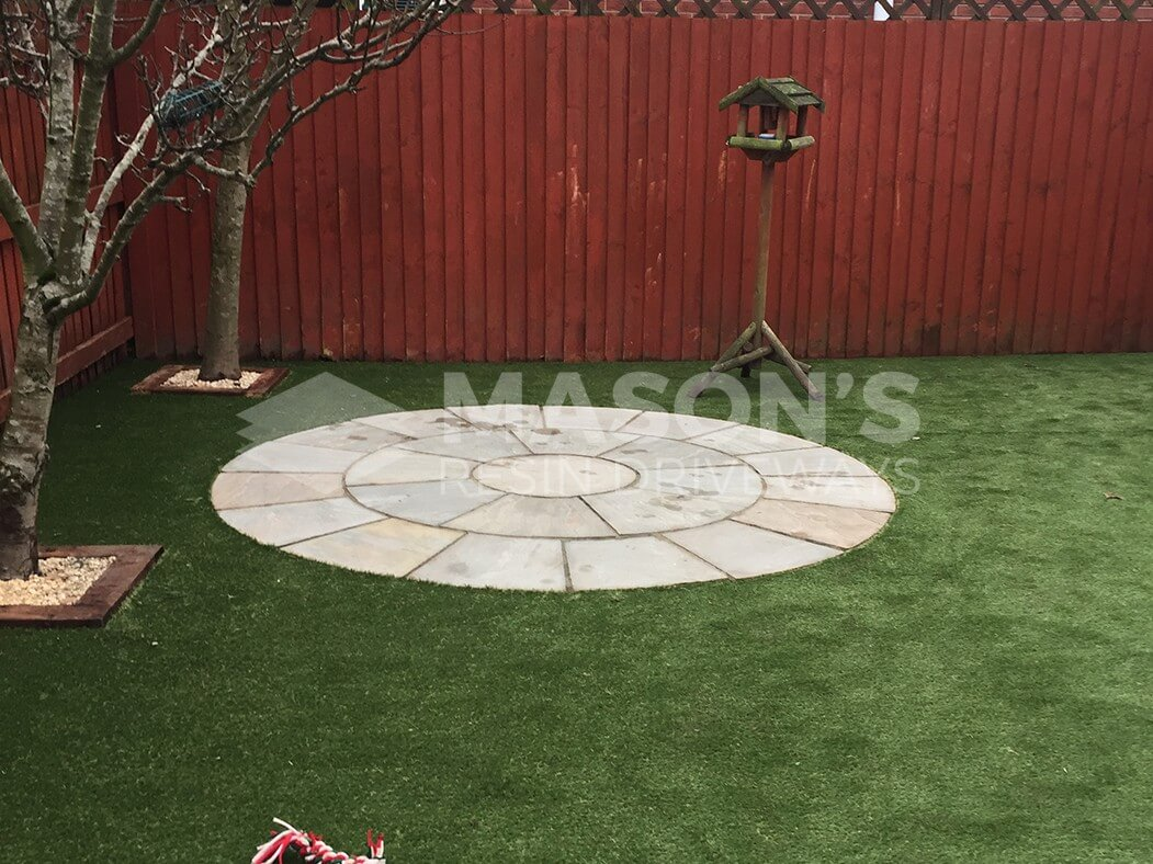 artificial lawn with circle paving done in leyland near preston