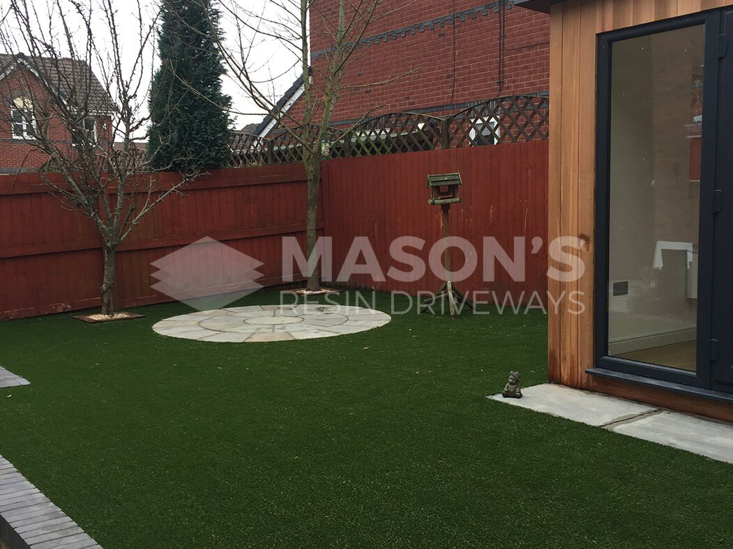 full view of artificial lawn and circle patterned paving done in leyland near preston