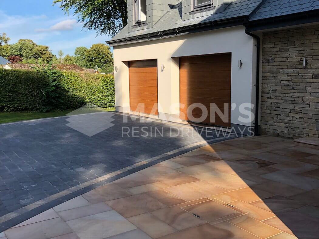 Garage shot of Block Paving Driveway and Indian Sandstone in Preston, Lancashire