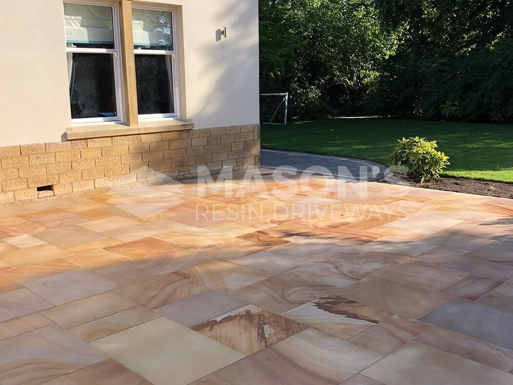 Window view of Indian Sandstone Block Paving Driveway job in Preston, Lancashire