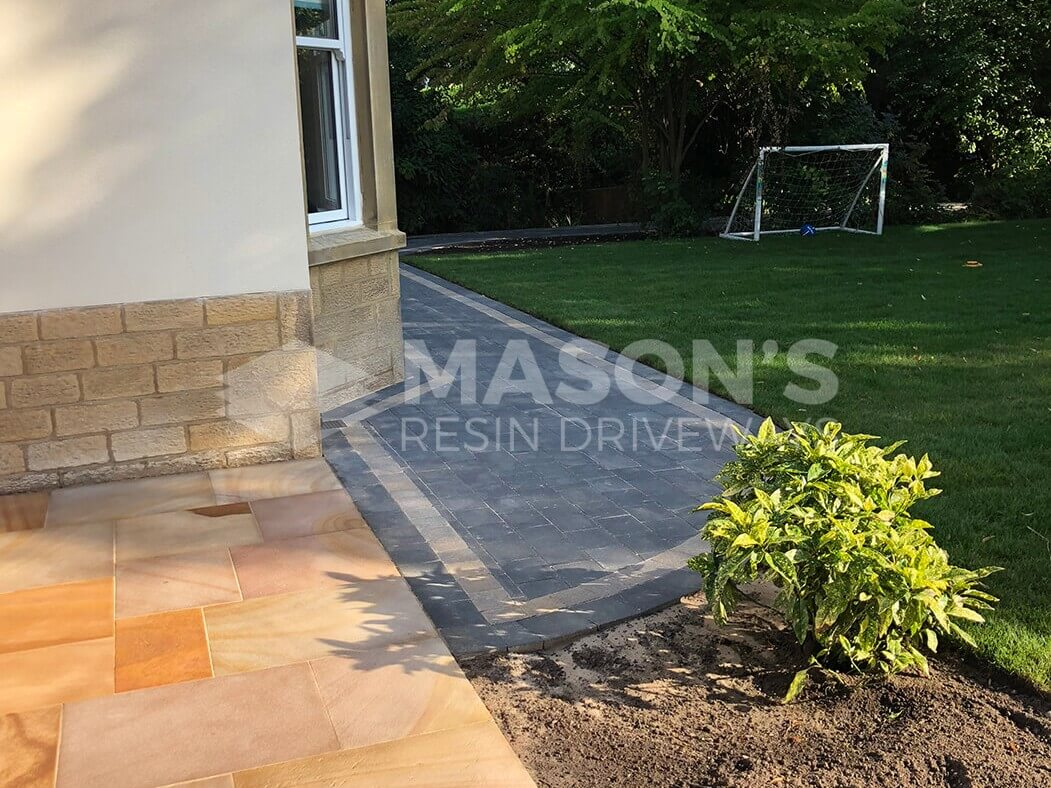 Back garden showing Block Paving Driveway and Indian Sandstone in Preston, Lancashire