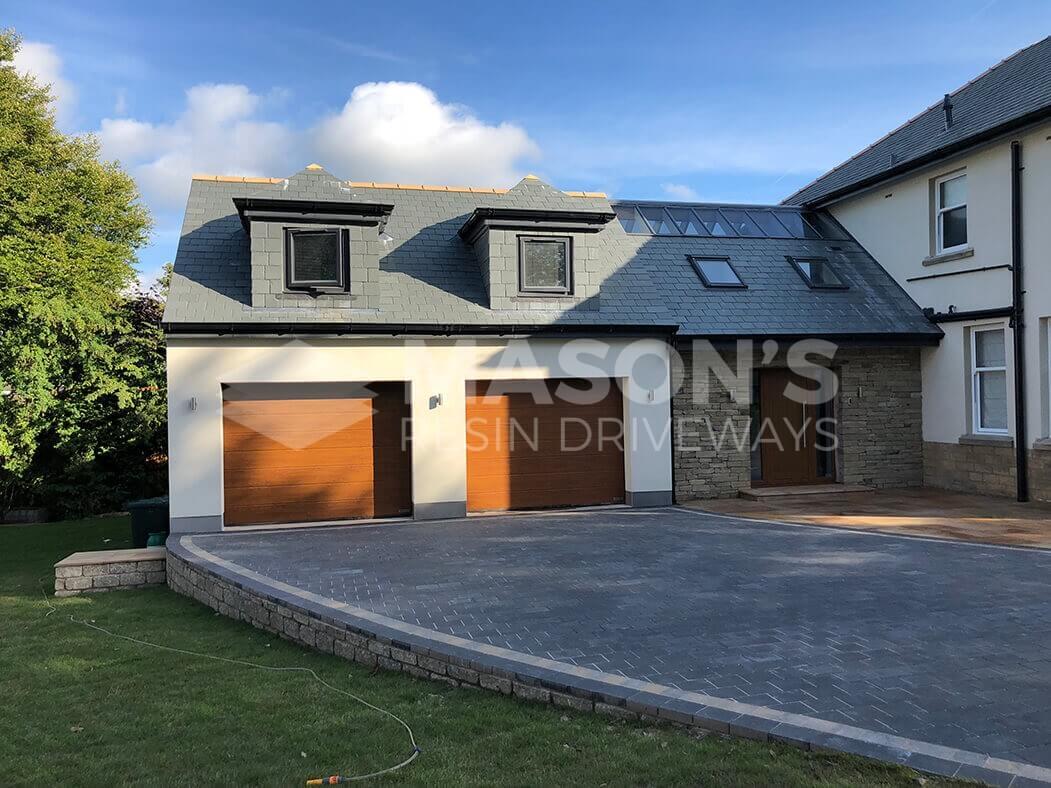 Wide shot of garage for Block Paving Indian Sandstone driveway job done in Preston, Lancashire