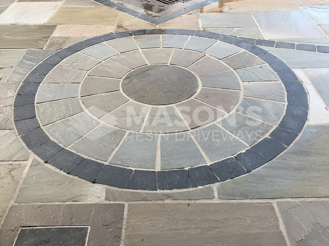 centre circle pattern of framed indian sandstone driveway preston, lancashire