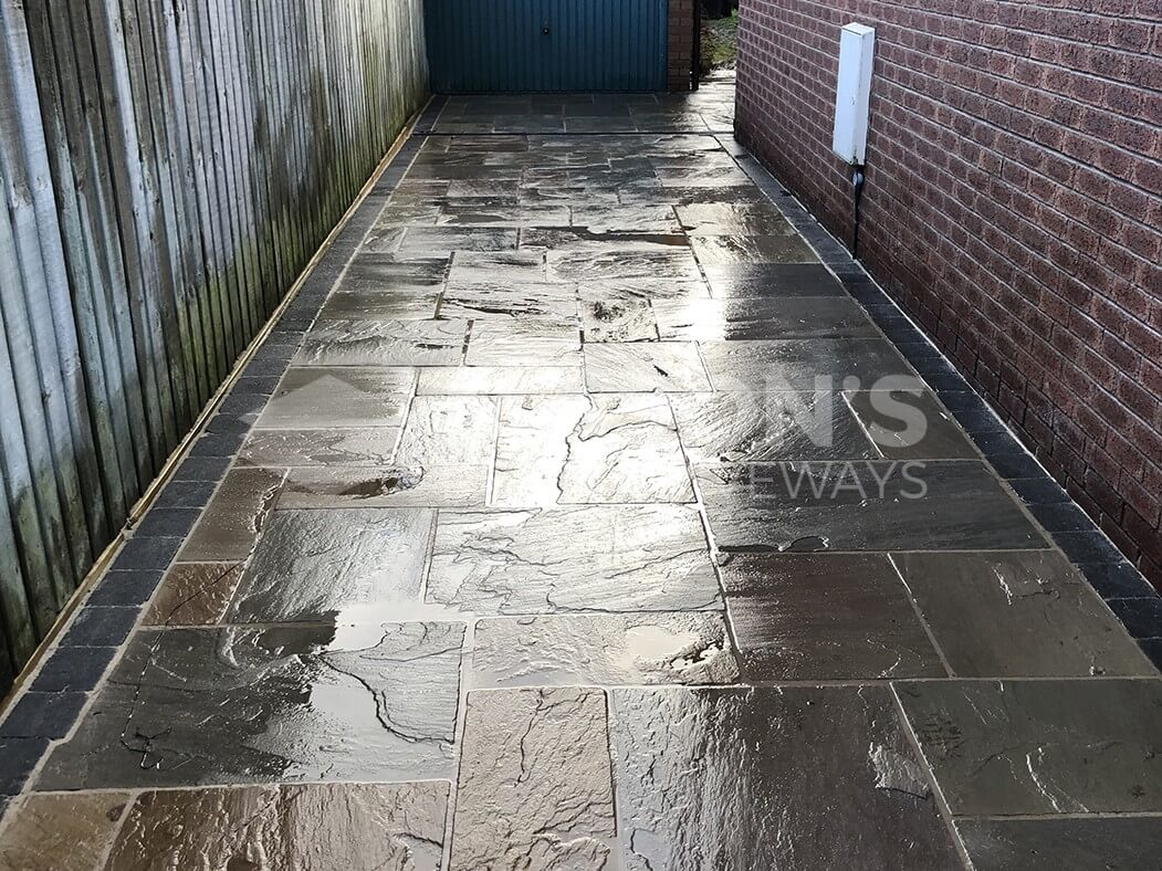 alley of indian sandstone flagged driveway in preston, lancashire