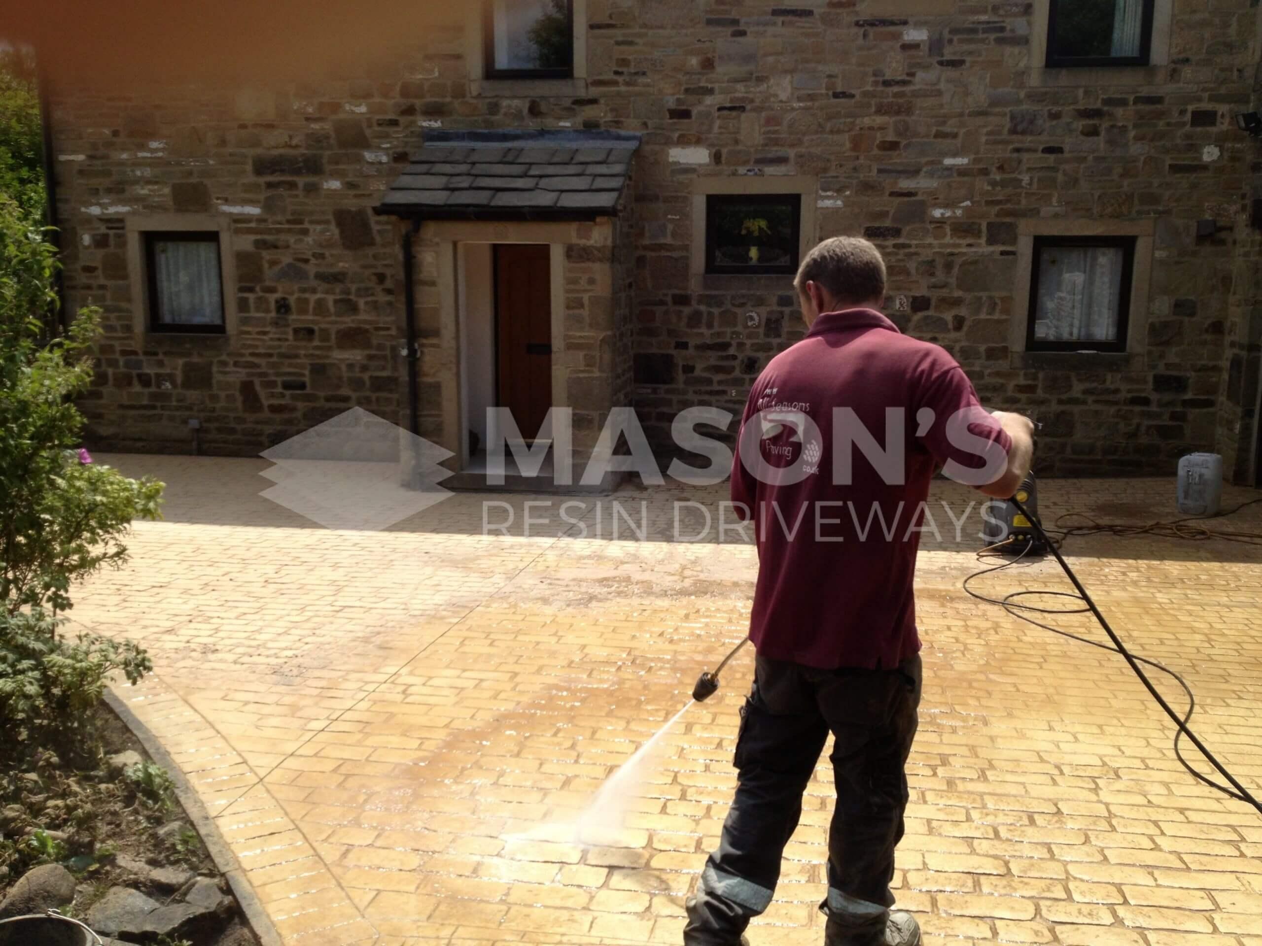 washing pattern imprinted concrete driveway near preston