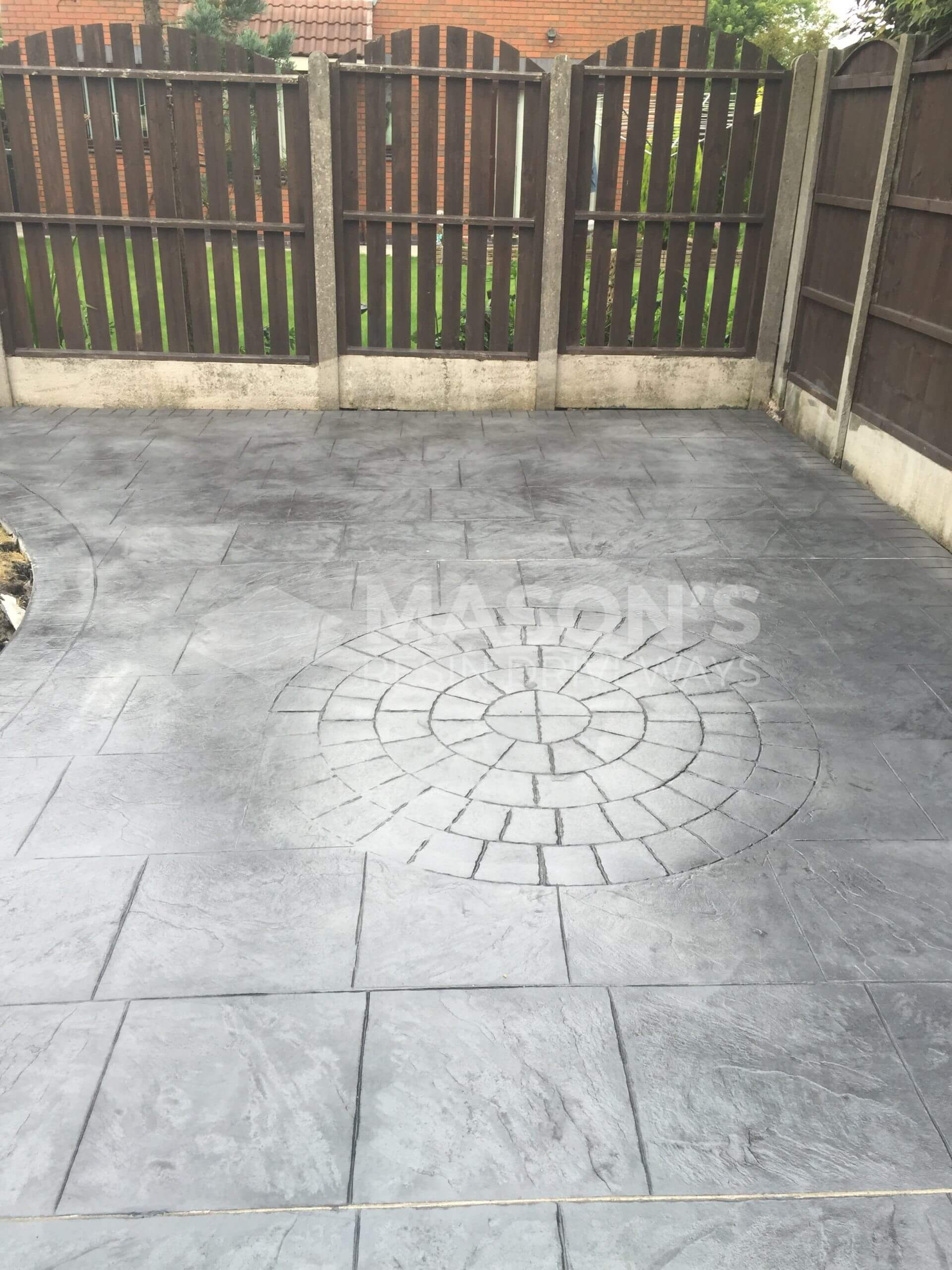 circle centre in pattern imprinted concrete driveway & patio in preston, lancashire