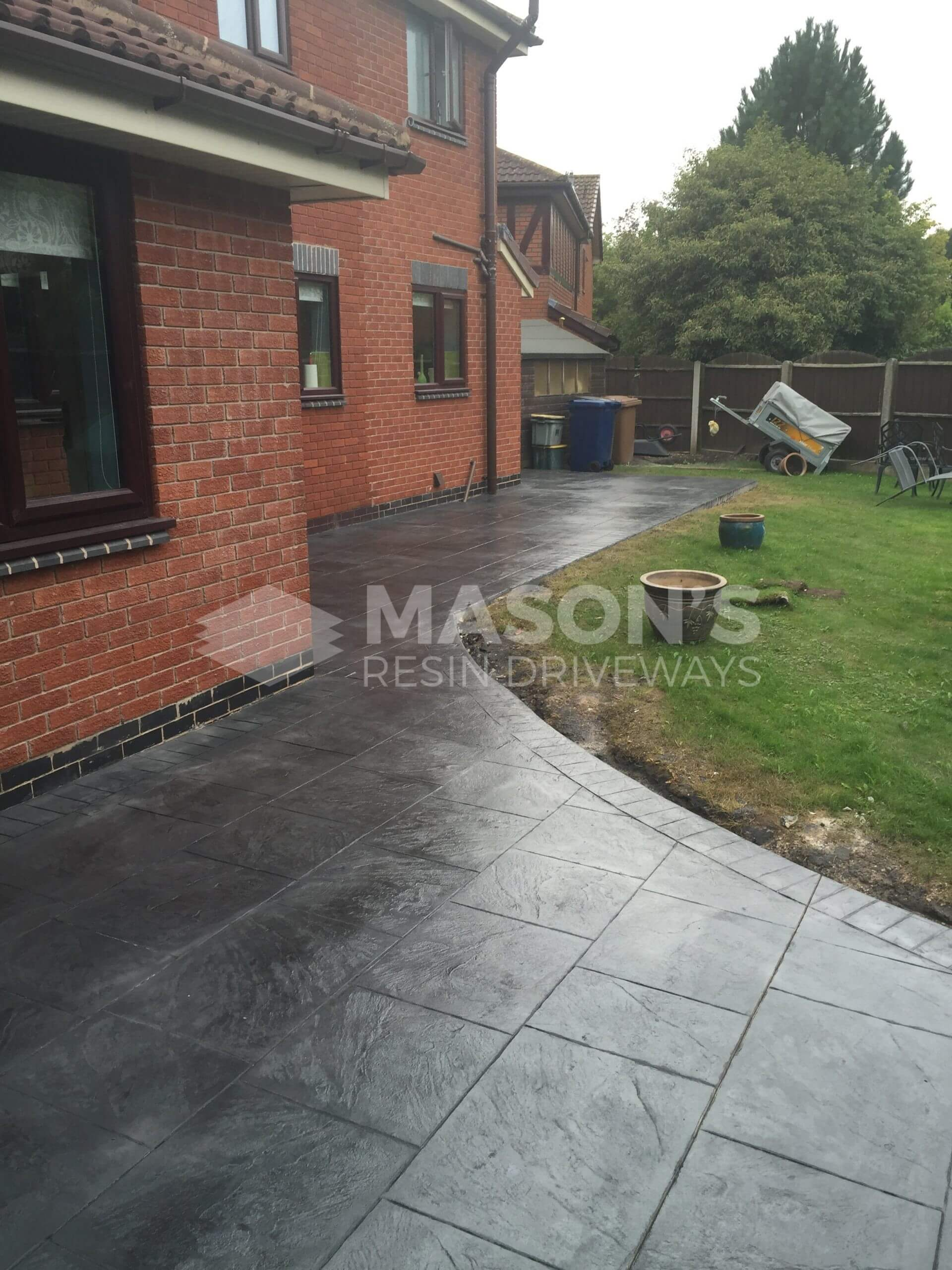 back garden of pattern imprinted concrete driveway, preston, lancashire