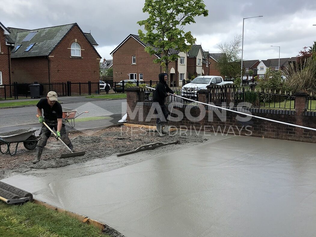 Workers in the process of the Pattern Imprinted Concrete Driveway in Preston