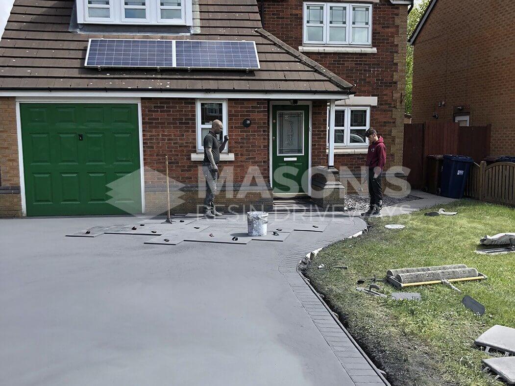 Laying down Pattern Imprinted Concrete Driveway, Preston