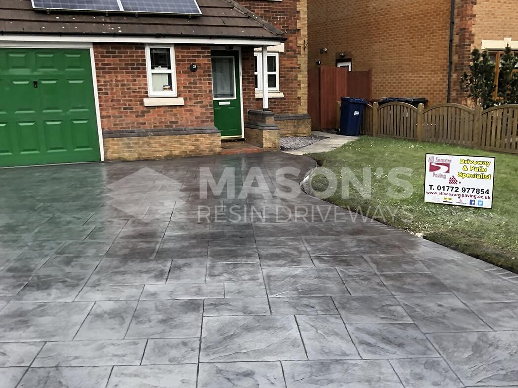 Finished Pattern Imprinted Concrete Driveway view showing our All Seasons Paving sign, Preston