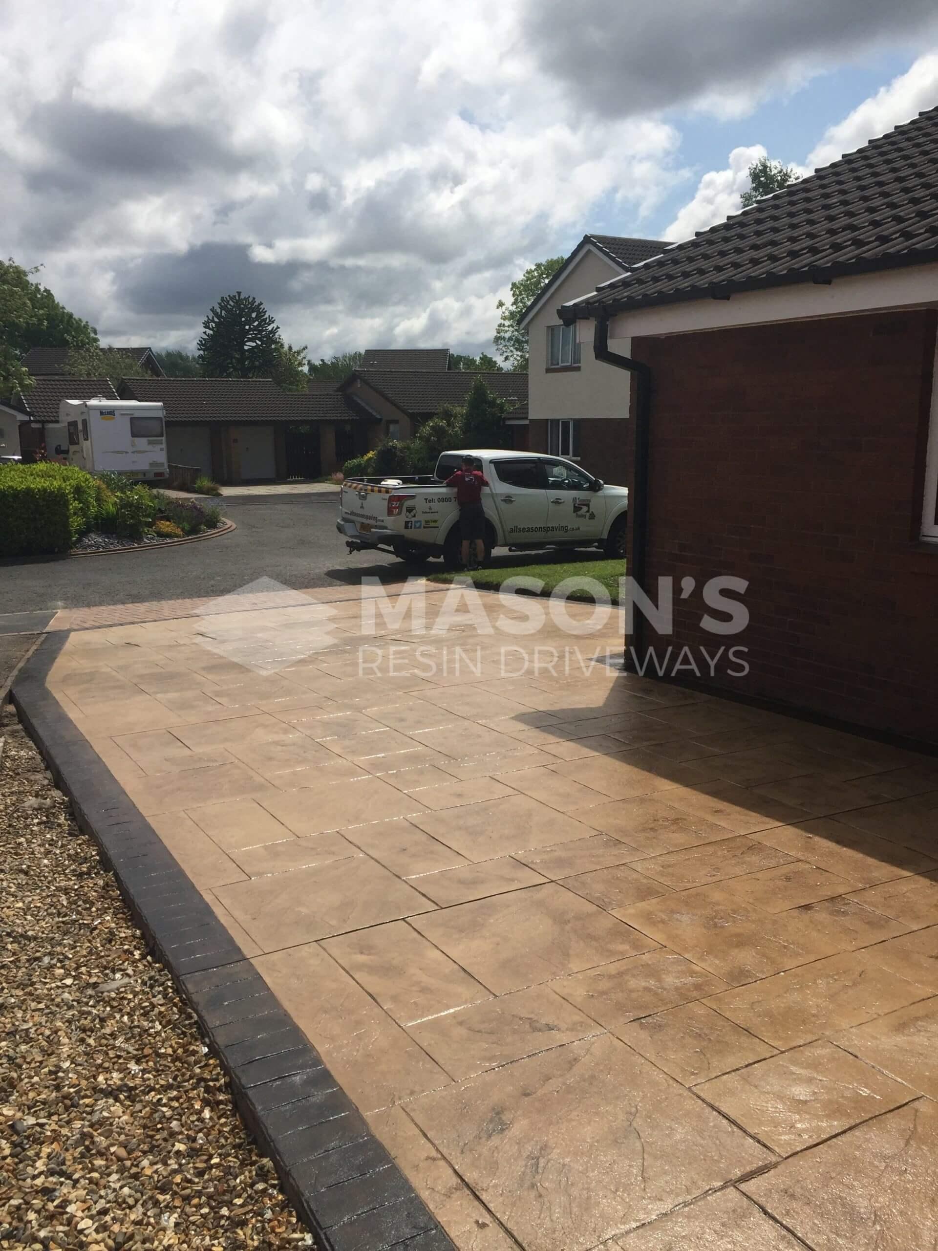 pattern imprinted concrete driveway in lea preston street view