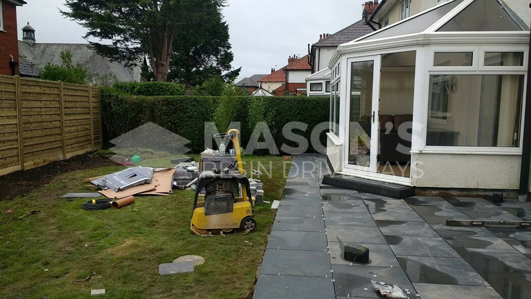 working on porcelain patio grey with tantalised fencing in penwortham, preston