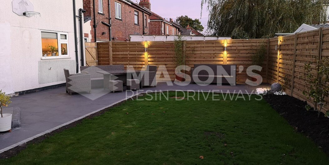 wide view of porcelain patio in preston, penwortham with tantalised fencing