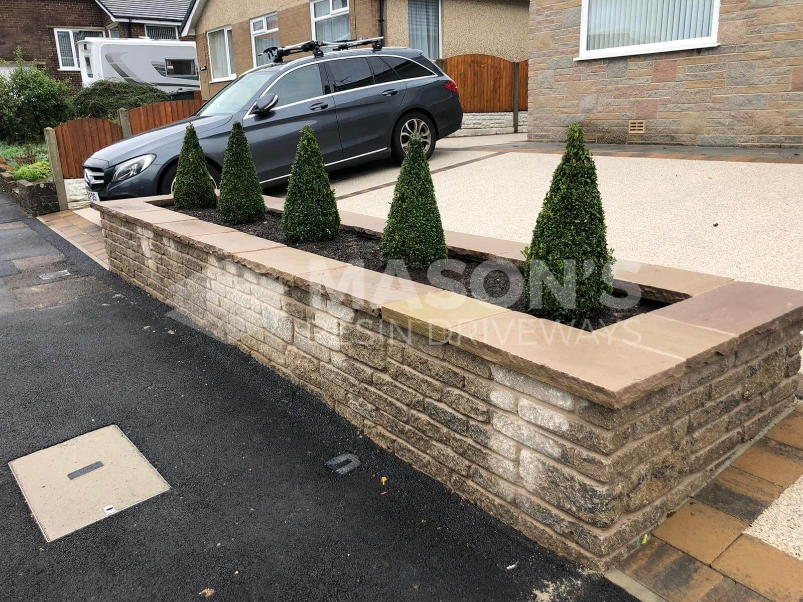 Resin bound driveway pearl quarts view of car and plants in Preston, Lancashire