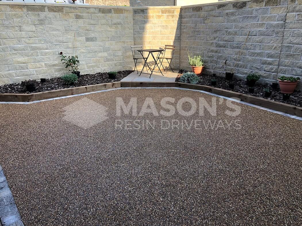 Resin patio area near Preston in Lancashire showing garden furniture.