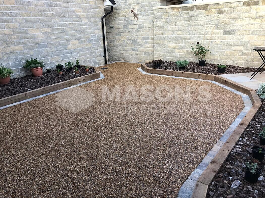 View of resin patio area near Preston in Lancashire showing wall art.