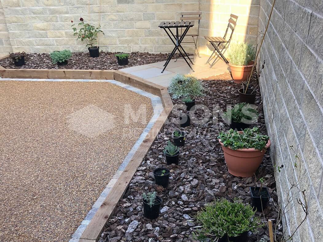 View of resin patio near Preston in Lancashire showing landscaped seating area.