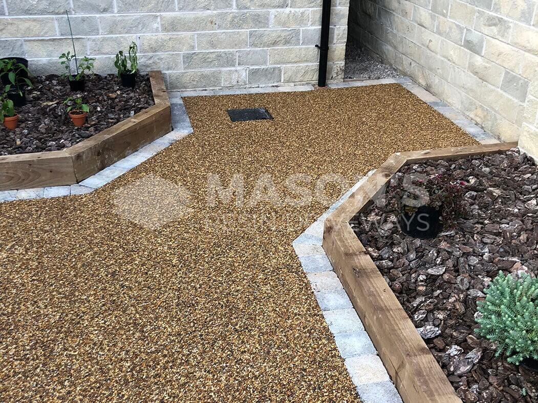 View of resin patio area near Preston in Lancashire showing drain access.