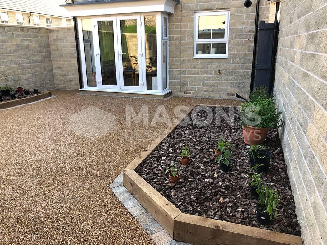 Resin Bound patio installed in Lancashire, near Preston showing raised flower bed.