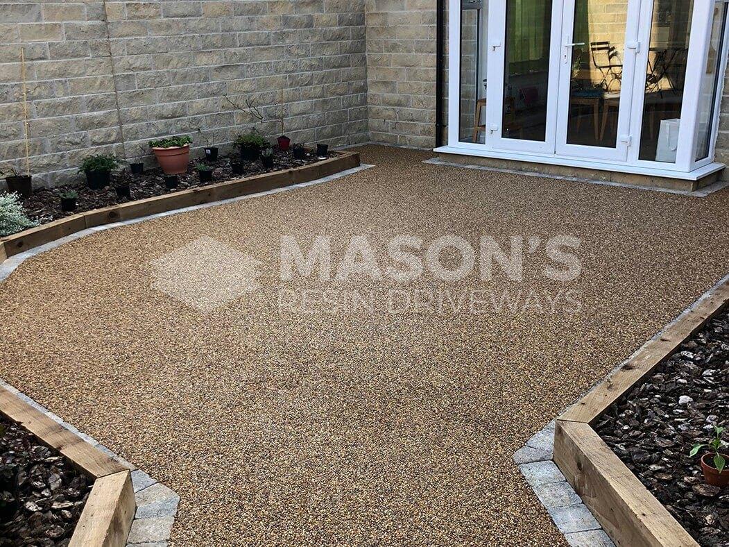 Resin Bound patio in Lancashire, near Preston showing finish to patio doors.