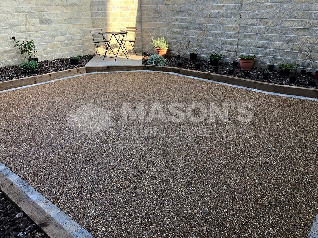 Resin patio installed in Lancashire, near Preston showing bistro garden furniture