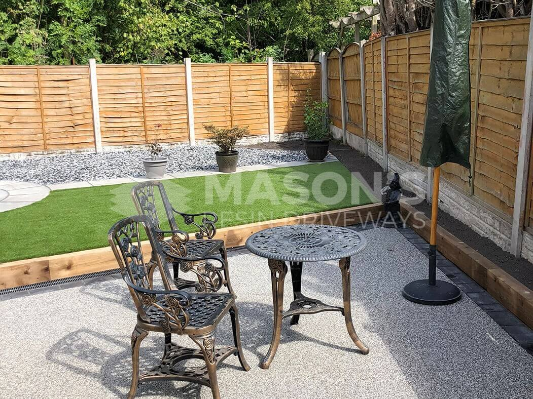 Resin bound driveway with table and chairs in Preston, Lancashire