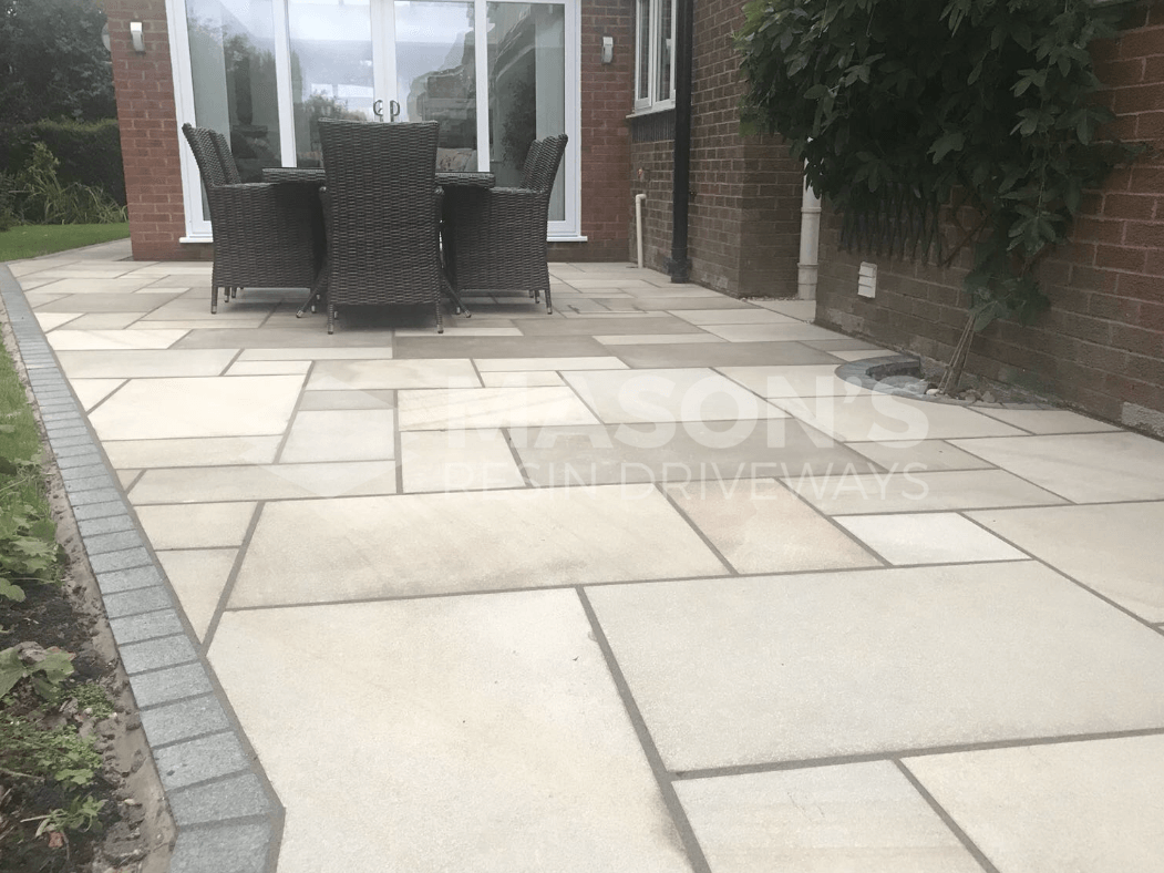 chair and table on sawn indian sandstone patio preston, lancashire