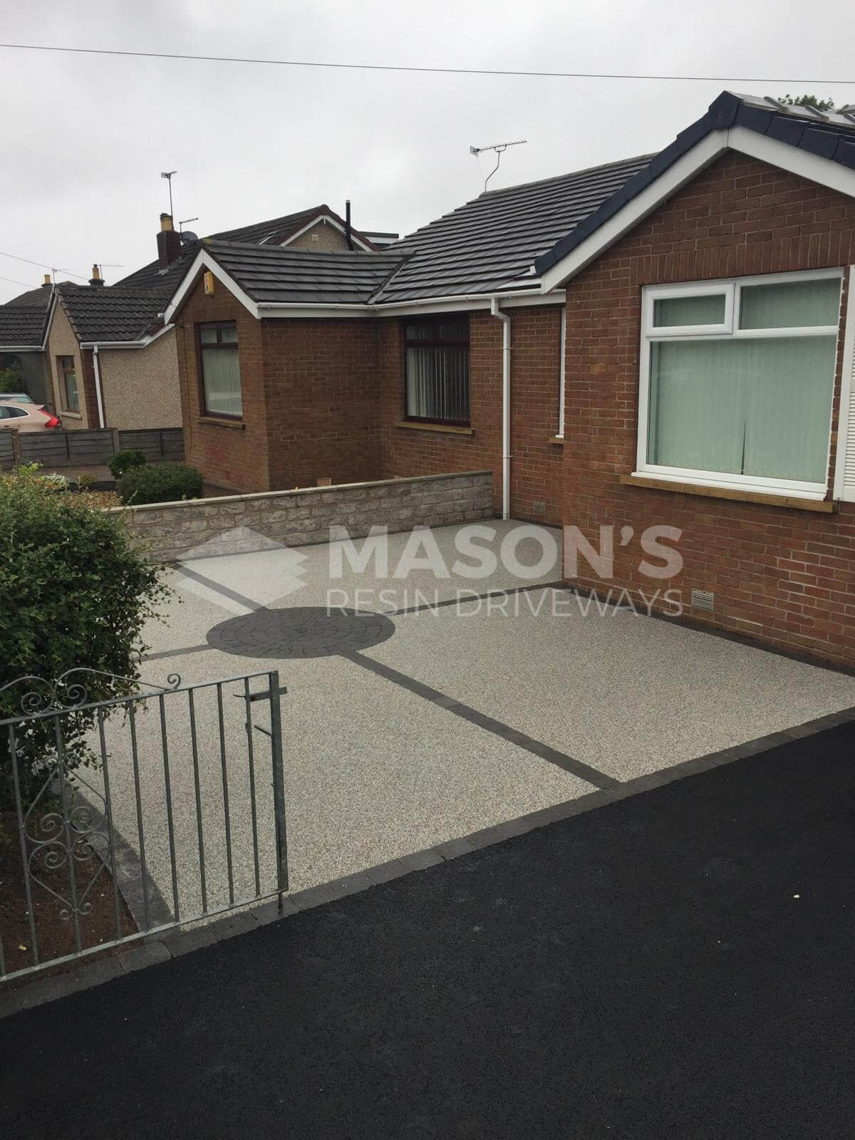 Silver quartz resin tarmac driveway portrait view in Preston, Lancashire