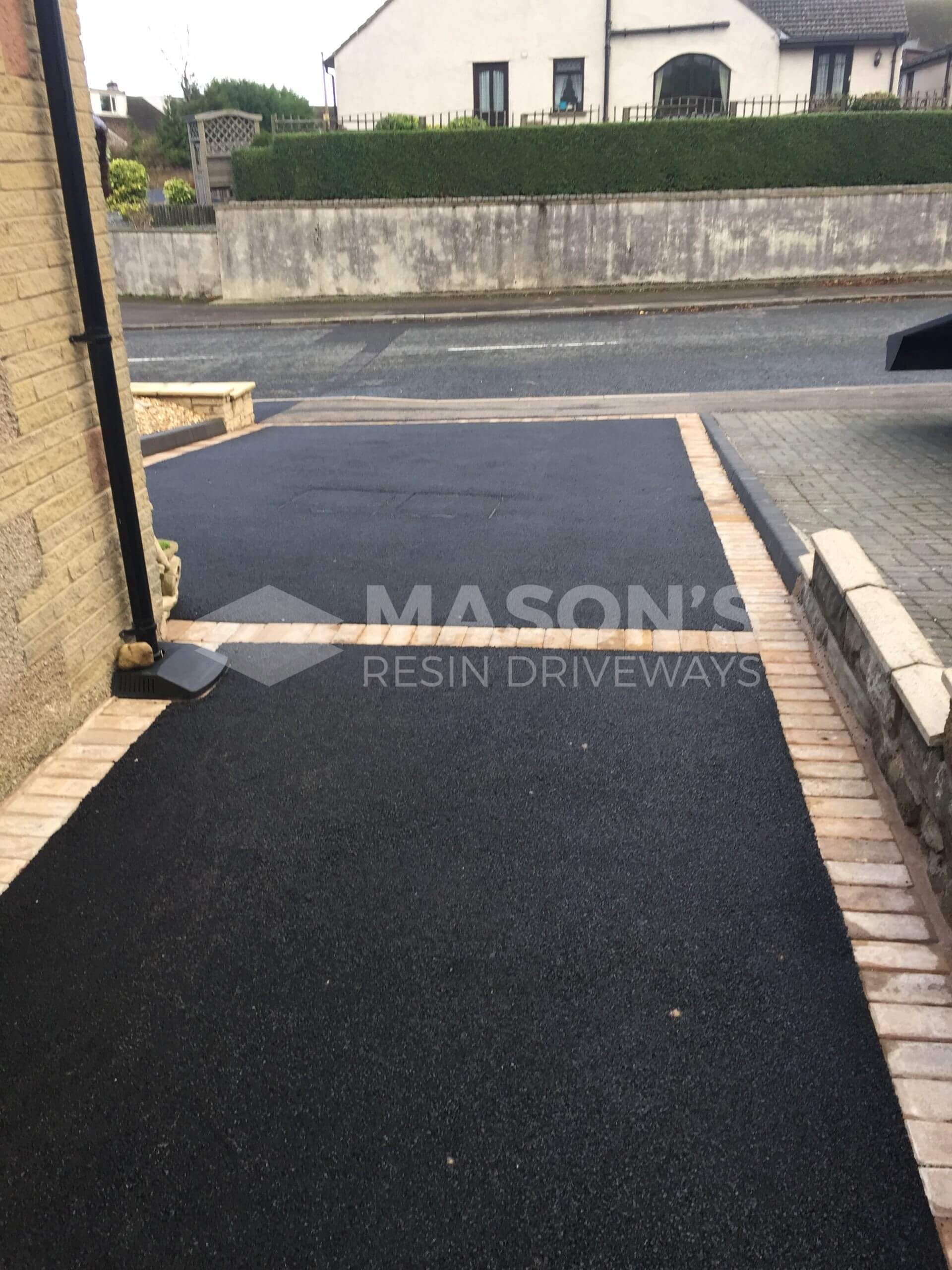 Tarmac driveway Preston framed in block paving