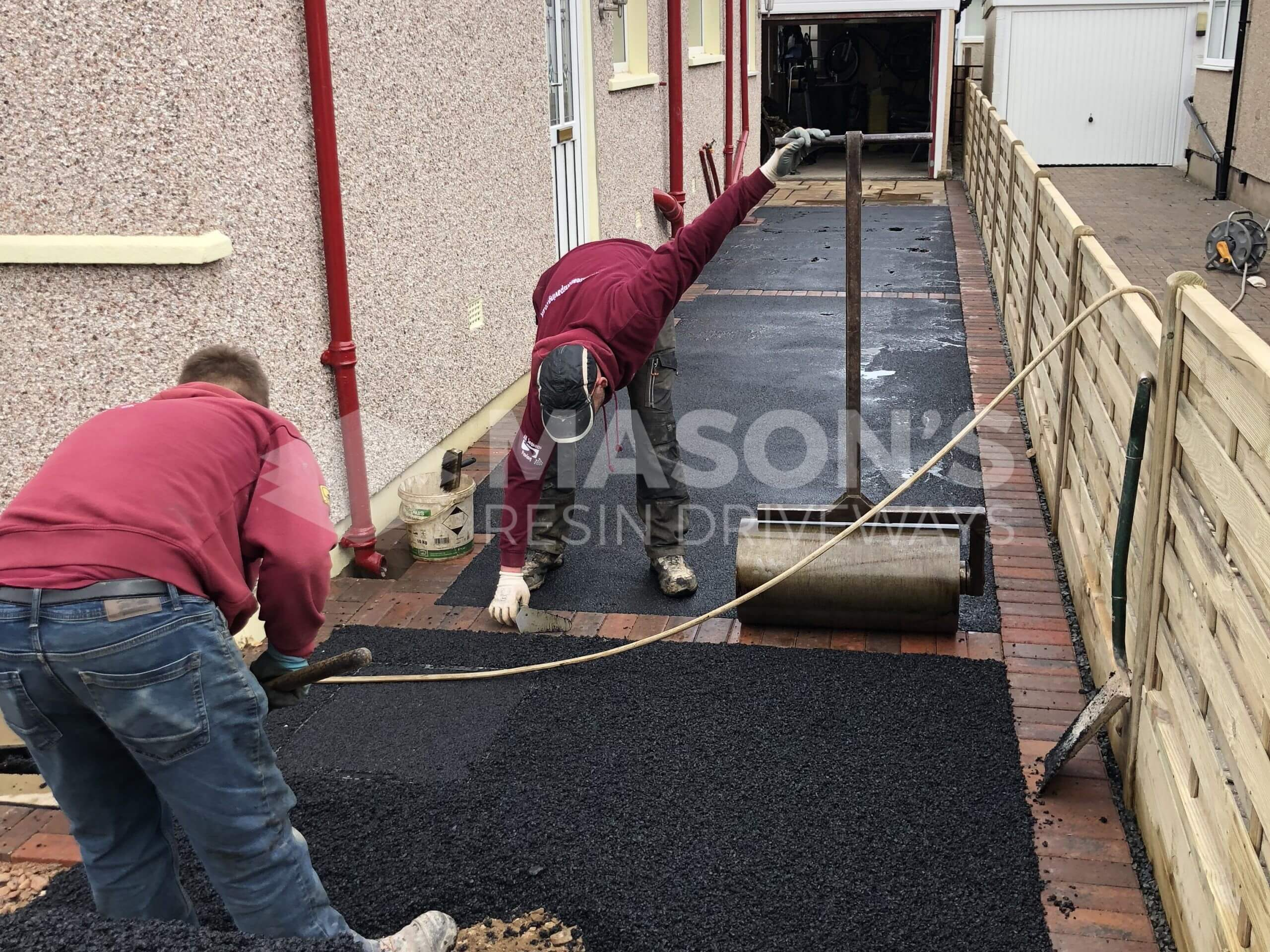 Workers on the Tarmac Driveway with Indian Sandstone in Preston, Lancashire