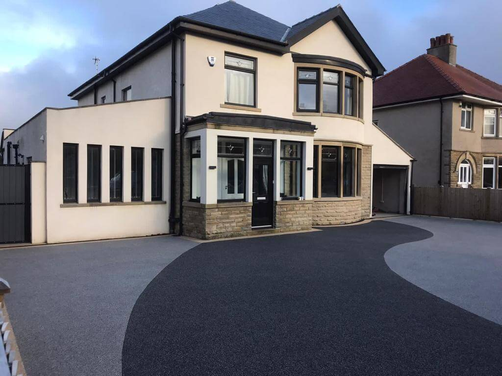 side view of house with resin driveway