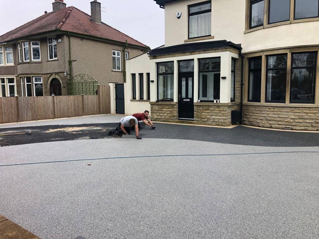 workers completing a resin bound driveway morecambe