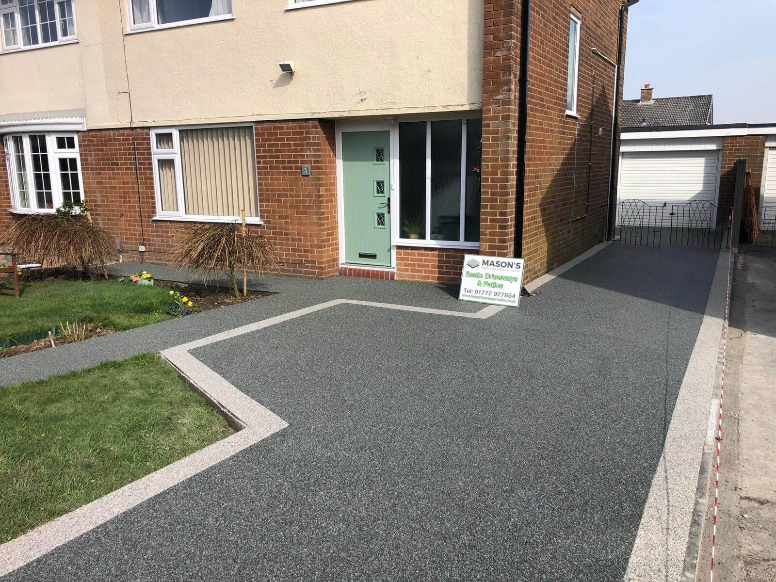 full view of slate grey resin bound driveway