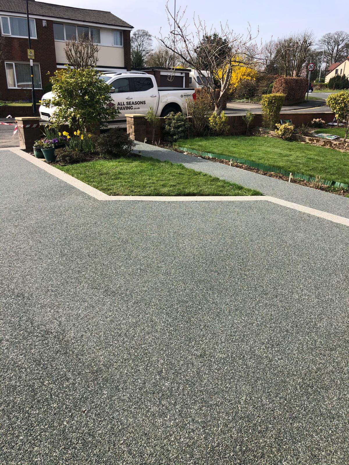 house with slate grey resin bound driveway