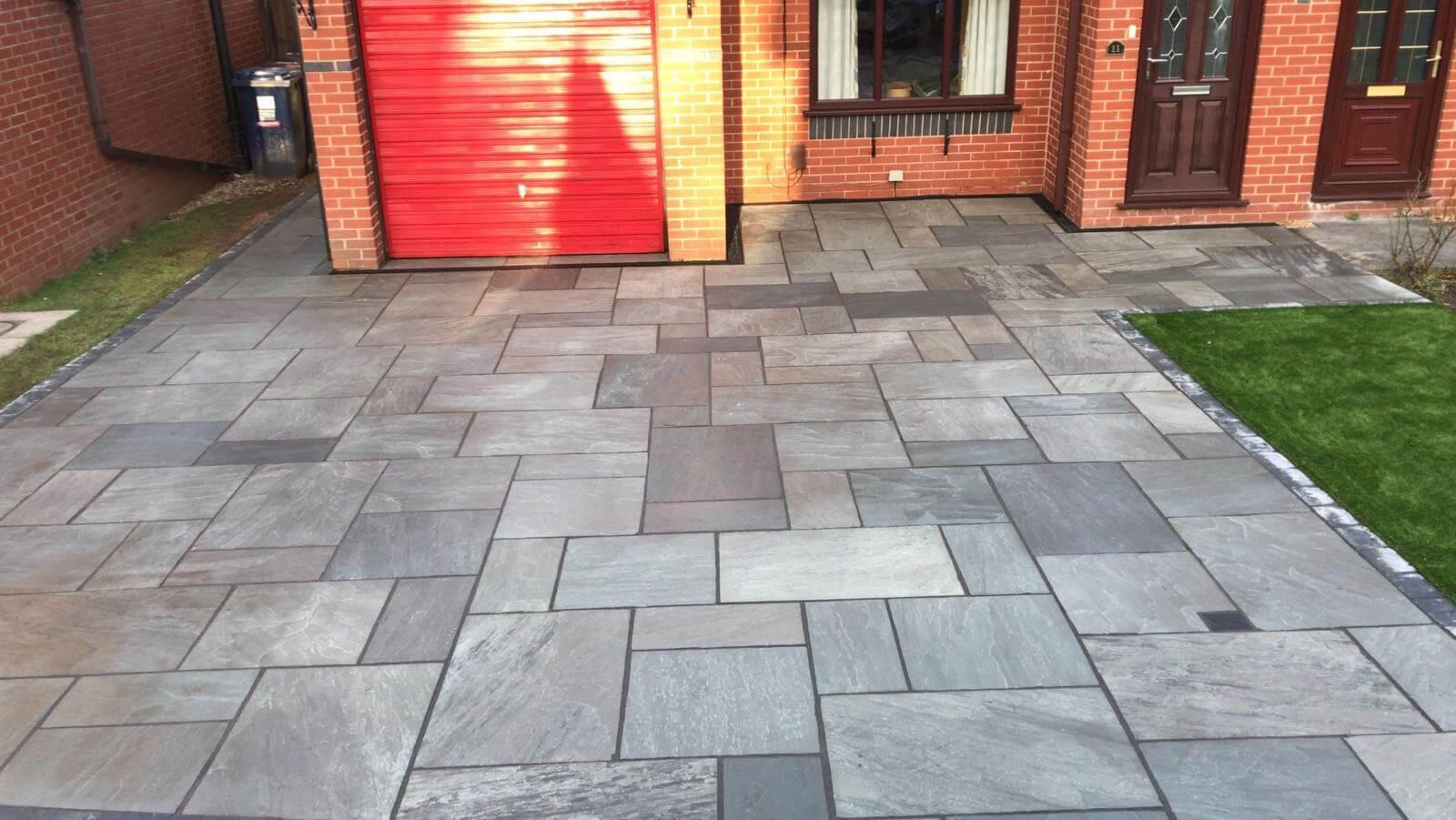 Indian sand stone driveway installed in Lostock hall Lancashire Tegula block border